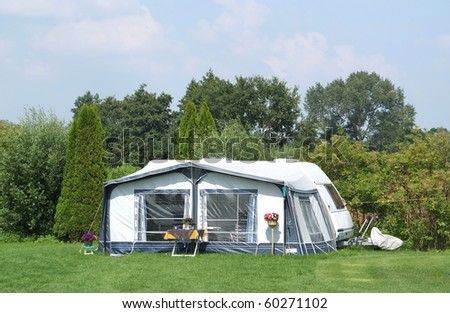 Caravan on a camp site, in the middle of nature. - stock photo