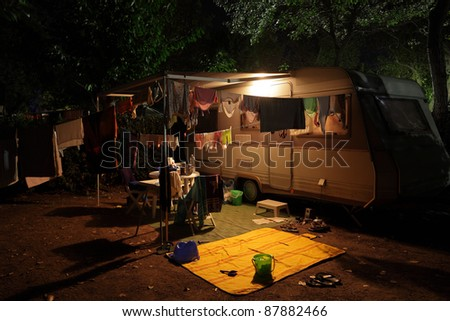 Caravan on a camping site in the evening - stock photo