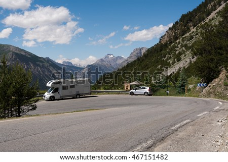 Caravan on the road in the Alps