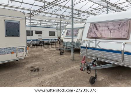 Caravan parking in an empty Dutch Greenhouse - stock photo