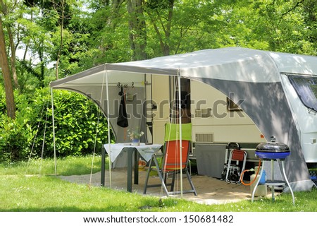 Caravan with a awning at a camp site - stock photo