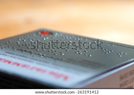 Carboard box of medicines labeled in Braille - stock photo