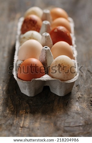 Carboard with chicken eggs. Selective focus, shallow DOF. - stock photo
