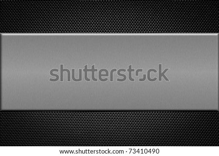 Carbon fiber background with  brushed aluminum plate. - stock photo