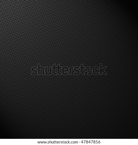 Carbon Fiber (Carbon Fibre) with top lighting to create atomsphere and shaded area. - stock photo