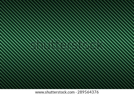 carbon kevlar texture background with green - stock photo