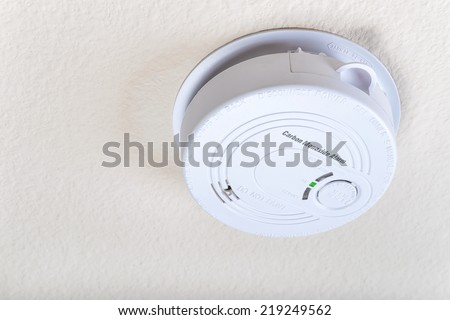 Carbon monoxide alarm on the ceiling  - stock photo