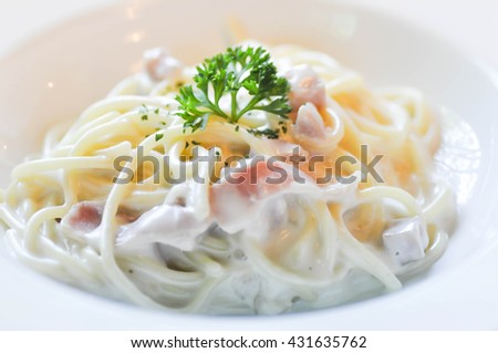 carbonara spaghetti  with ham dish on the table - stock photo