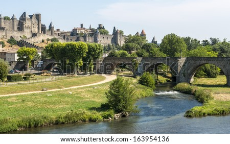 Carcassonne (Aude, Languedoc-Roussillon, France) - The historic bridge and the river in a summer afternoon