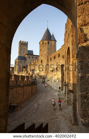 CARCASSONNE, FRANCE - JULY 20, 2013: Tourists take in the sights of the medieval citadel of Carcassonne in south-west France.  - stock photo
