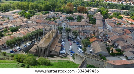 CARCASSONNE, LANGUEDOC - ROUSSILLON, FRANCE - SEPTEMBER 13, 2013: The Church of Eglise Saint-Gimer and surrounding part of the old town of Carcassonne taken from the city wall.