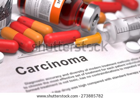 Carcinoma - Printed Diagnosis with Blurred Text. On Background of Medicaments Composition - Red Pills, Injections and Syringe. - stock photo