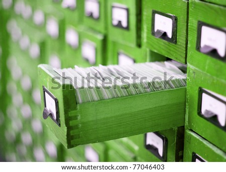 card catalog or cabinet with opened drawer and files - stock photo