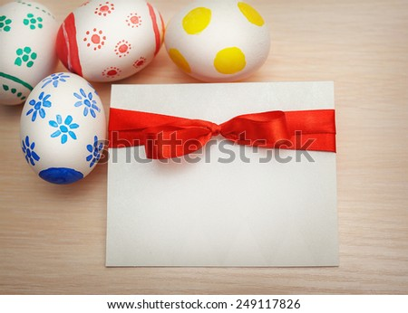 card colored easter eggs with space for your text. - stock photo