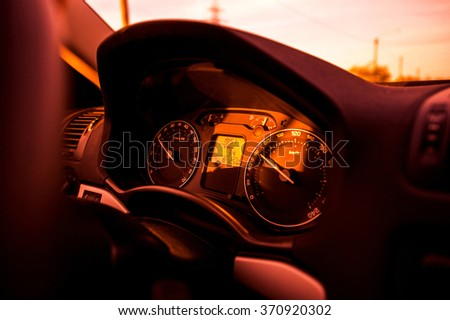 Card dashboard in motion with odometer showing 60 kmh and focus on the digital display - security red tone - regular speed on most countries - stock photo