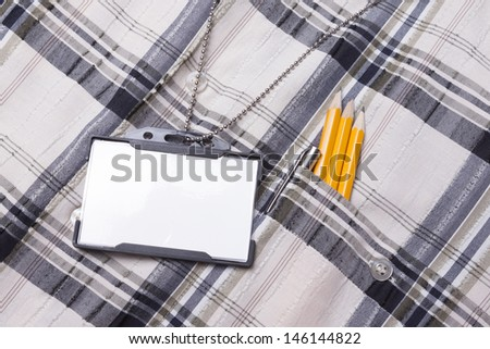 Card empty ID badge on man suit - stock photo