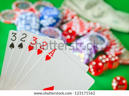 Card for poker in the hand, chips and card for poker - stock photo