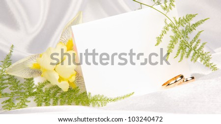 card for text  on white silk