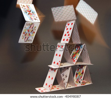 Card house with the flying cards - stock photo