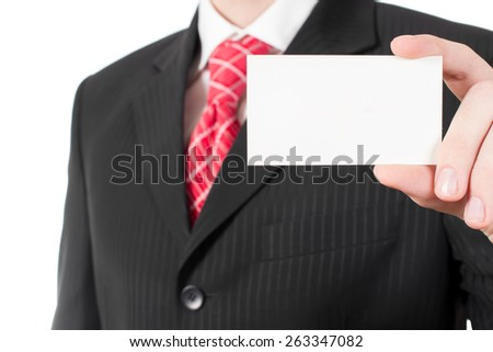Card in hand at the man in the suit - stock photo