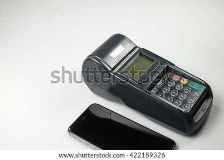 Card machine, black smartphone on white background.