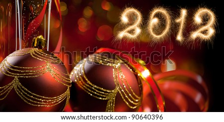 Card. New Year 2012 made of real sparkles and Christmas spheres - stock photo