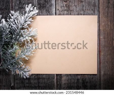 Card with  Christmas tree on wooden background  - stock photo