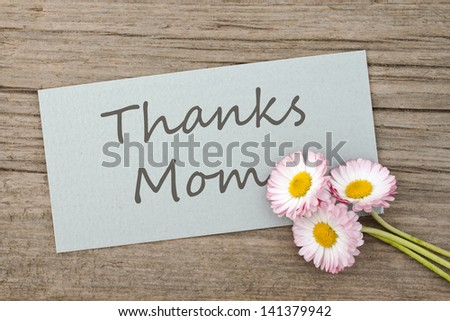 card with lettering thanks mom and daisies/thanks/daisies