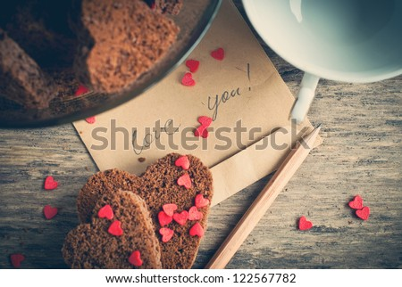 Card with Message Love You on the Letter and Chocolate Cookies Shape of Heart at Valentine's Day - stock photo