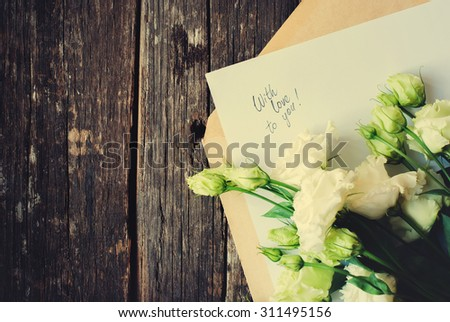 Card with Message with Love You on the Letter and Light Geen Roses to Valentine's Day - stock photo