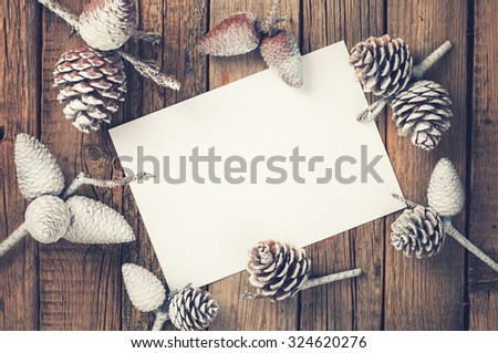 Card with pine cones .A letter for Christmas and New year.Toned image. Vintage style.Copy space. selective focus. - stock photo