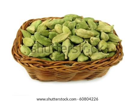 Cardamom or cardamon green elettaria in woven basket - stock photo