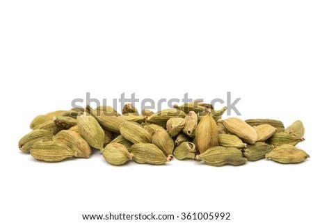 cardamom pods isolated on white - stock photo