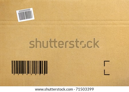 Cardboard background of a closed package box with printed bar-code - stock photo