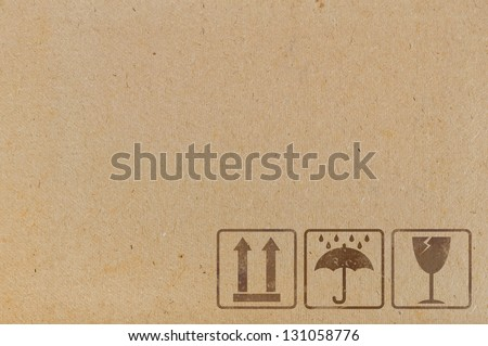 Cardboard  background with  icons used on containers and packaging - stock photo