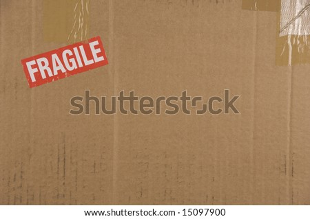 Cardboard Box Background with Fragile in red with copy-space - stock photo