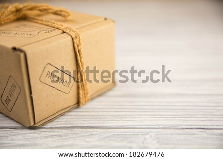 cardboard box isolated on white wood background - stock photo