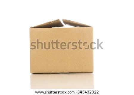 Cardboard box isolated over white background - stock photo