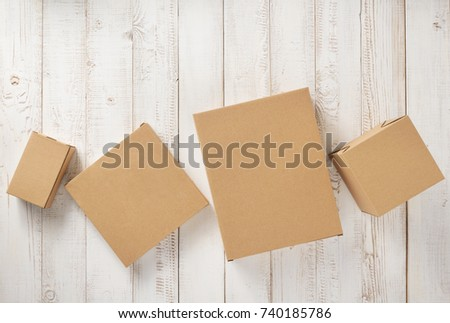 cardboard box on white wooden background