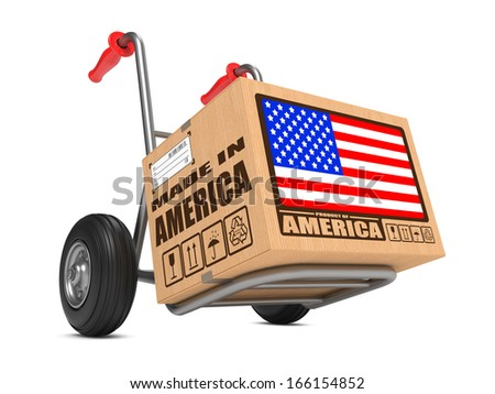 Cardboard Box with Flag of USA and Made in America Slogan on Hand Truck White Background. Free Shipping Concept. - stock photo