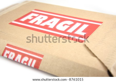 Cardboard box with Fragile on it, isolated on white