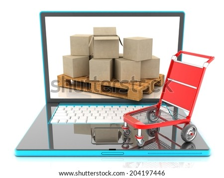 Cardboard boxes on a laptop. concept of e-commerce. - stock photo