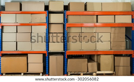 Cardboard Boxes On Shelves In Distribution Warehouse - stock photo