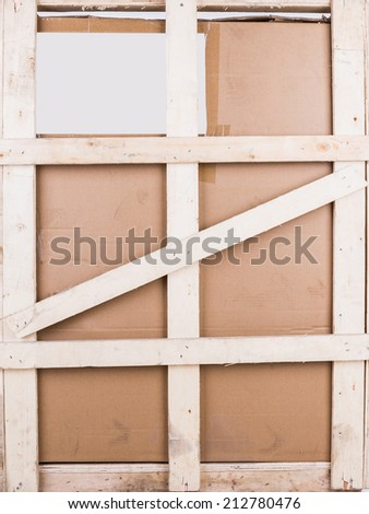 Cardboard boxes with wooden reinforcement - stock photo