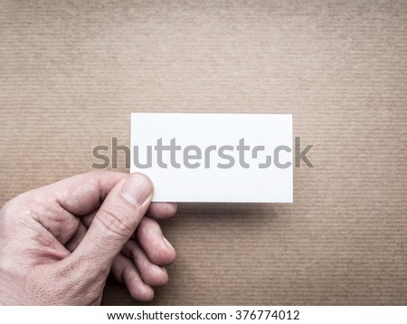 Cardboard business card Mockup in man's hand