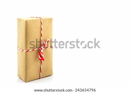 Cardboard carton wrapped with brown paper, tied with string on white background.  - stock photo