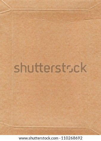 cardboard empty space for the text background brown yellow textured and dark reflections - stock photo