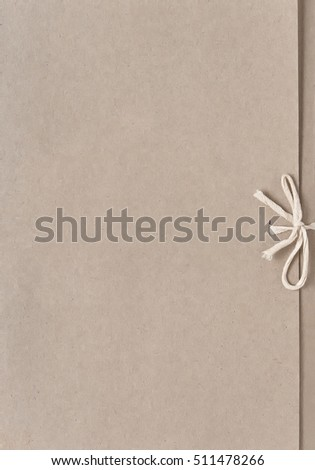 Cardboard folder for papers with rope ties