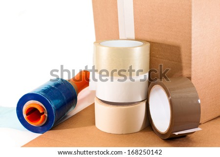 Cardboard for packaging, adhesive tape and nylon on white background - stock photo