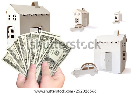 Cardboard houses, automobiles symbol and hands holding money (American Dollars ) on the white background - stock photo